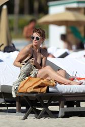 http://img142.imagevenue.com/loc204/th_312907942_Mischa_Barton_Bikini_Candids_on_the_Beach_in_Miami_December_27_2011_278_122_204lo.jpg