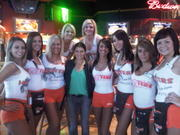 Danica Patrick at a Hooters posing with the girls